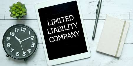 Chalk board illustrating how to set up a limited liability company