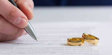 A pair of rings placed upon divorce papers