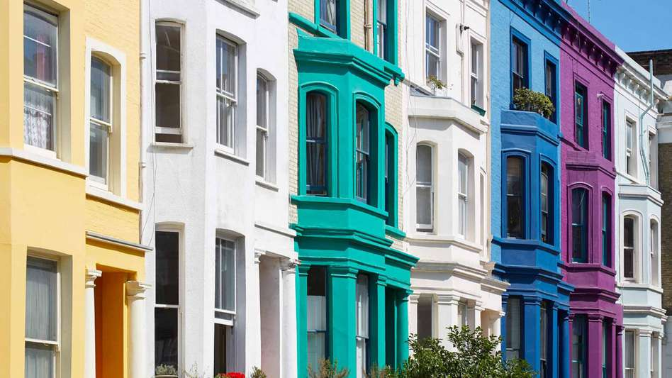 Brightly coloured terrace houses in a row