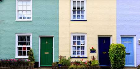 Row of three brightly coloured houses
