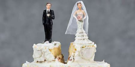 Wedding cake with a divide between the bride and groom
