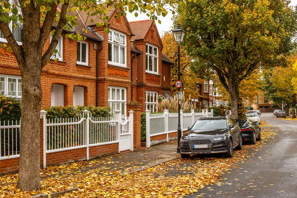 Suburban London street with cars parked on the road